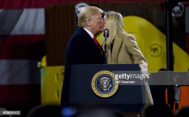President Donald Trump kisses his daughter Ivanka Trump after she spoke to supporters at a rally at HK Equipment a rental and sales company for...