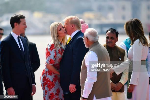 US President Donald Trump kisses White House senior advisor Ivanka Trump as India's Prime Minister Narendra Modi looks on upon their arrival at...