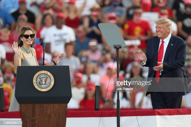President Donald Trump laughs as Hope Hicks, a senior adviser to the president, speaks to the crowd after the president brought her on stage during a...