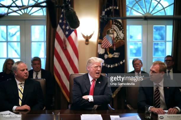S President Donald Trump leads a meeting of his Cabinet including acting Interior Secretary David Bernhardt and acting Defense Secretary Patrick...