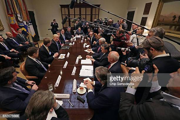 S President Donald Trump leads a meeting with invited business leaders members of his staff and Vice President Mike Pence in the Roosevelt Room at...