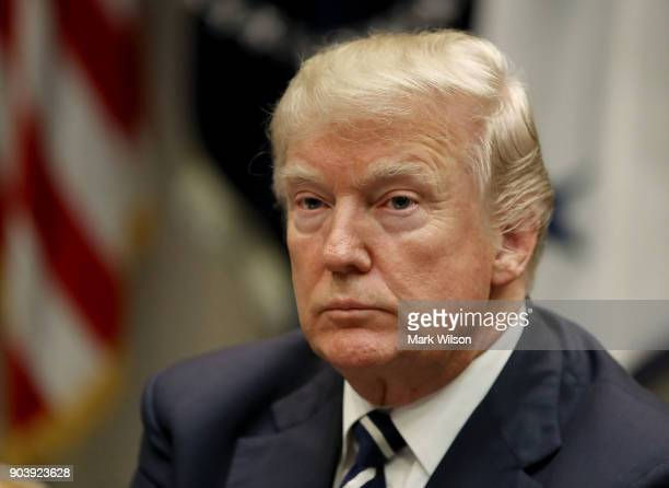 S President Donald Trump leads a prison reform roundtable in the Roosevelt Room at the White House on January 11 2018 in Washington DC State and...