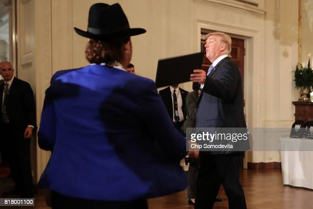 S President Donald Trump leaves a Made in America product showcase in the East Room of the White House July 17 2017 in Washington DC American...