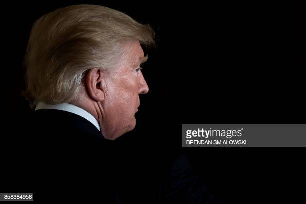 President Donald Trump leaves after a Hispanic Heritage Month event in the East Room of the White House October 6, 2017 in Washington, DC. -...
