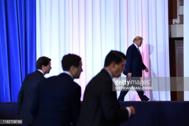 President Donald Trump leaves after a press conference on the sidelines of the G20 Summit in Osaka on June 29, 2019.
