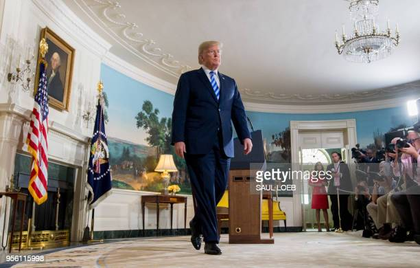 President Donald Trump leaves after announcing his decision about the nuclear deal with Iran during a speech from the Diplomatic Reception Room at...