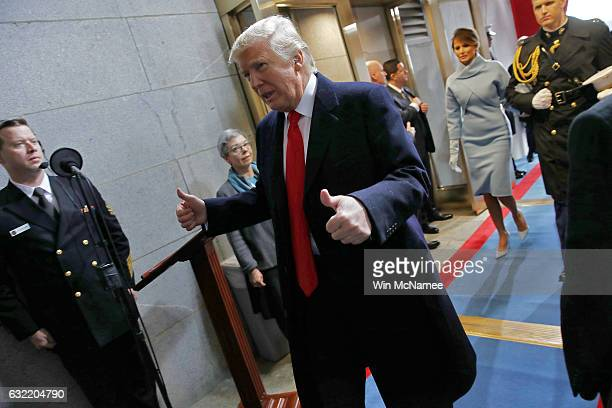 S President Donald Trump leaves after being sworn in followed by first lady Melania Trump on the West Front of the US Capitol on January 20 2017 in...