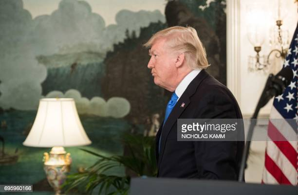 US President Donald Trump leaves after delivering a statement in the Diplomatic Room at the White House in Washington DC on June 14 2017 after House...