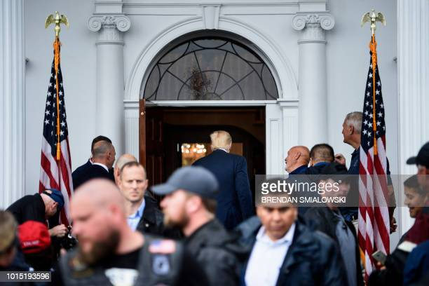 US President Donald Trump leaves after greeting supporters during a Bikers for Trump event at the Trump National Golf Club August 11 2018 in...