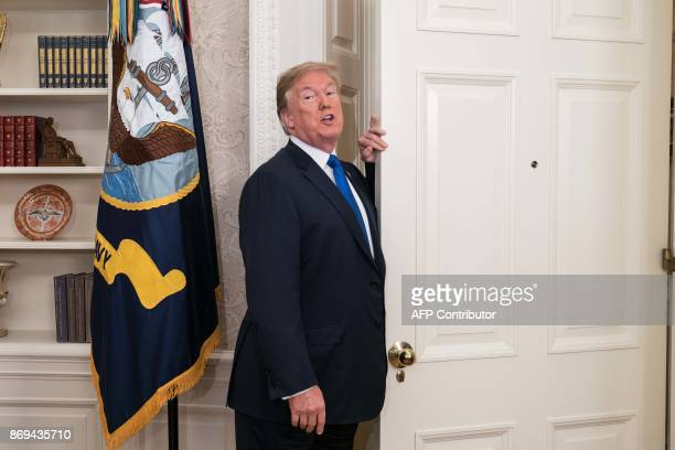 US President Donald Trump leaves after he announced that Broadcom woud be moving back to the US in the Oval Office at the White House in Washington...