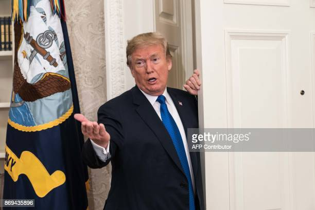 US President Donald Trump leaves after he announced that Broadcom would be moving back to the US in the Oval Office at the White House in Washington...