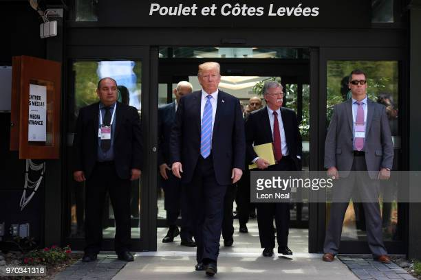 President Donald Trump leaves after holding a press conference ahead of his early departure from the G7 Summit on June 9 2018 in Quebec City Canada...