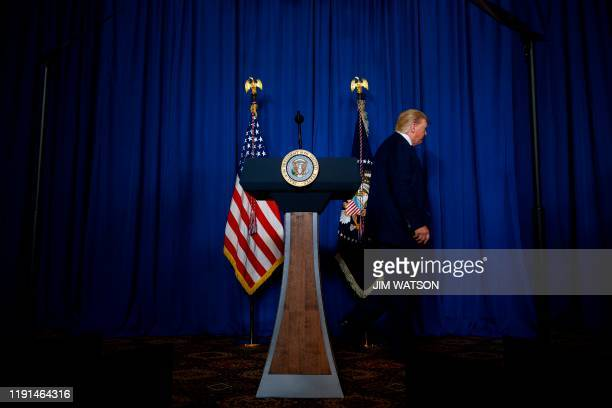President Donald Trump leaves after making a statement on Iran at the Mar-a-Lago estate in Palm Beach Florida, on January 3, 2020. - President Donald...