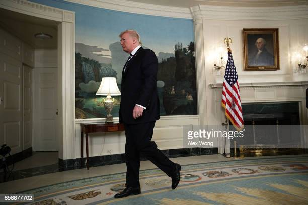 S President Donald Trump leaves after making a statement on the Las Vegas mass shooting at the Diplomatic Room of the White House October 2 2017 in...