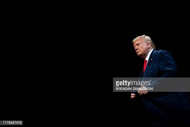 President Donald Trump leaves after signing an executive order regarding Medicare at Sharon L. Morse Performing Arts Center October 3 in The...