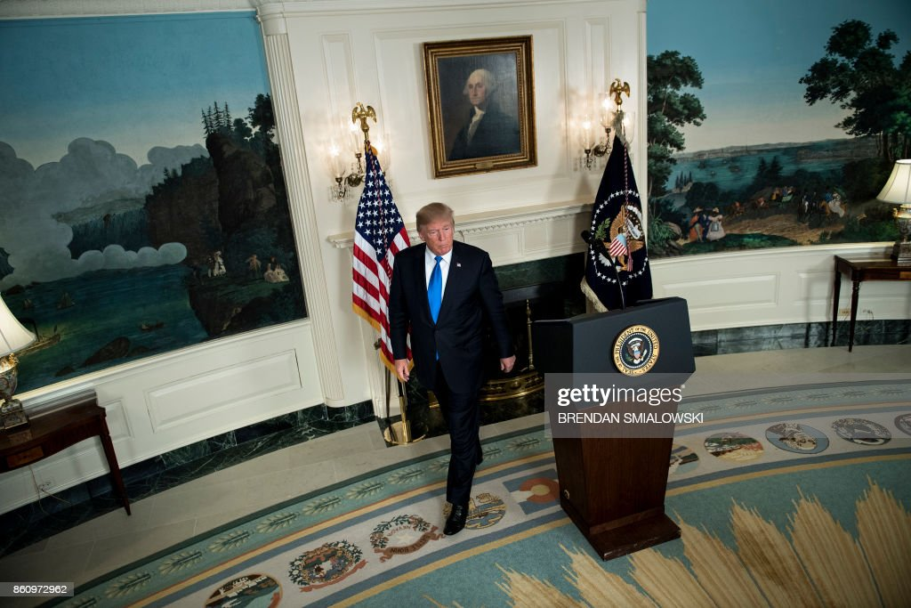 US President Donald Trump leaves after speaking about the Iran deal from the Diplomatic Reception room of the White House in Washington, DC, on October 13, 2017. Trump announced he will not certify the Iran nuclear deal and warned that the US could leave the Iran deal 'at any time.' / AFP PHOTO / Brendan Smialowski