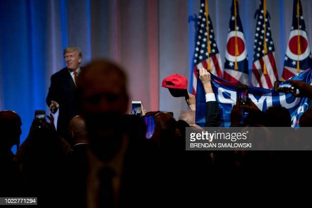 US President Donald Trump leaves after speaking at the Ohio Republican Party State Dinner at the Greater Columbus Convention Center August 24 2018 in...