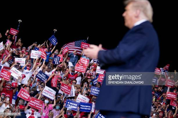 President Donald Trump leaves after speaking during a campaign rally at Cecil Airport on September 24 in Jacksonville, Florida.