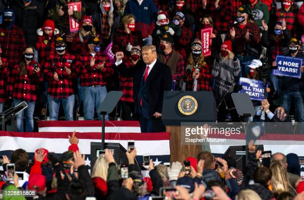 President Donald Trump leaves after speaking during a campaign rally at the Duluth International Airport on September 30, 2020 in Duluth, Minnesota....