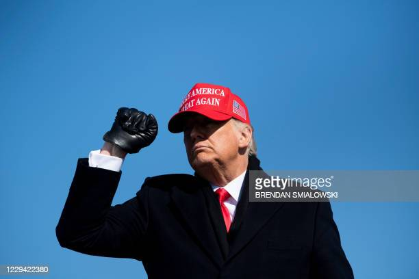 President Donald Trump leaves after speaking during a Make America Great Again rally at Fayetteville Regional Airport November 2 in Fayetteville,...