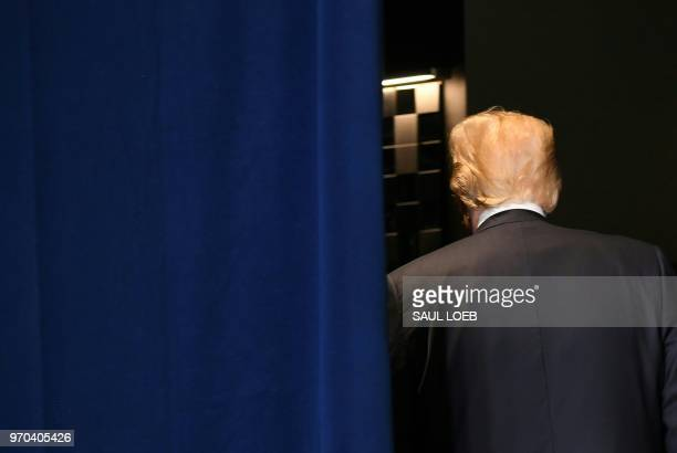 US President Donald Trump leaves after speaking to reporters during a press conference at the G7 Summit on June 9 in La Malbaie Quebec Canada