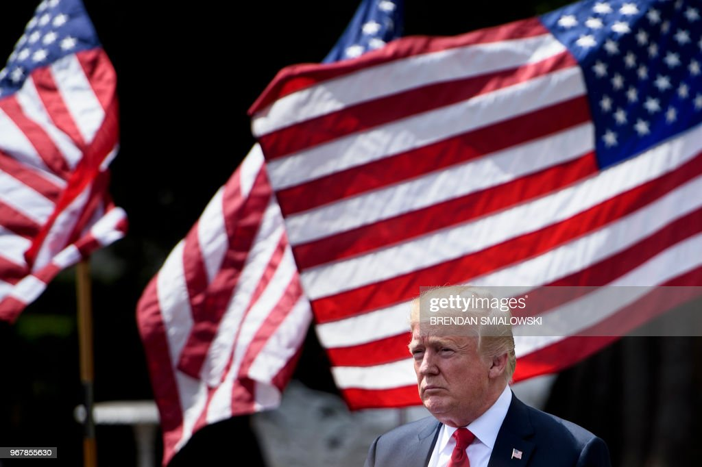 President Donald Trump leaves after the 'Celebration of America' at the White House in Washington, DC, on June 5, 2018. - Trump's 'The Celebration of America' honors football fans and not the NFL champions Philadelphia Eagles after he reignited his feud with the league by abruptly canceling a White House reception for the Super Bowl winners over players who kneel during the national anthem to protest social injustice.