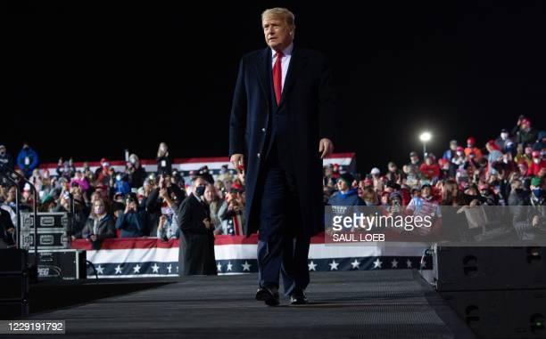 President Donald Trump leaves at the end of a Make America Great Again rally at Erie International Airport in Erie, Pennsylvania, October 20, 2020.