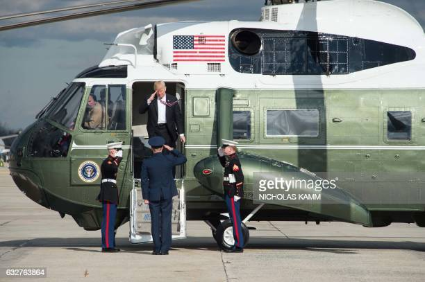 President Donald Trump leaves Marine One before boarding Air Force One at Andrews Air Force Base in Maryland on January 26 2017 as he departs to...