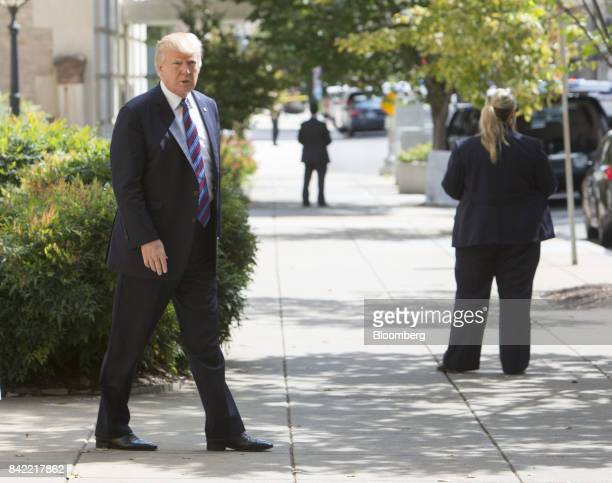 US President Donald Trump leaves St John's Church after a national day of prayer for the people affected by Hurricane Harvey in Washington DC US on...