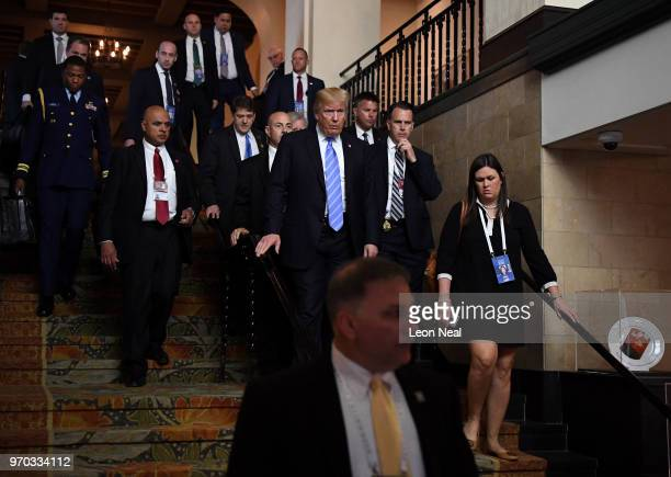 President Donald Trump leaves the main building alongside White House Press Secretary Sarah Huckabee Sanders during the G7 Summit on June 9 2018 in...