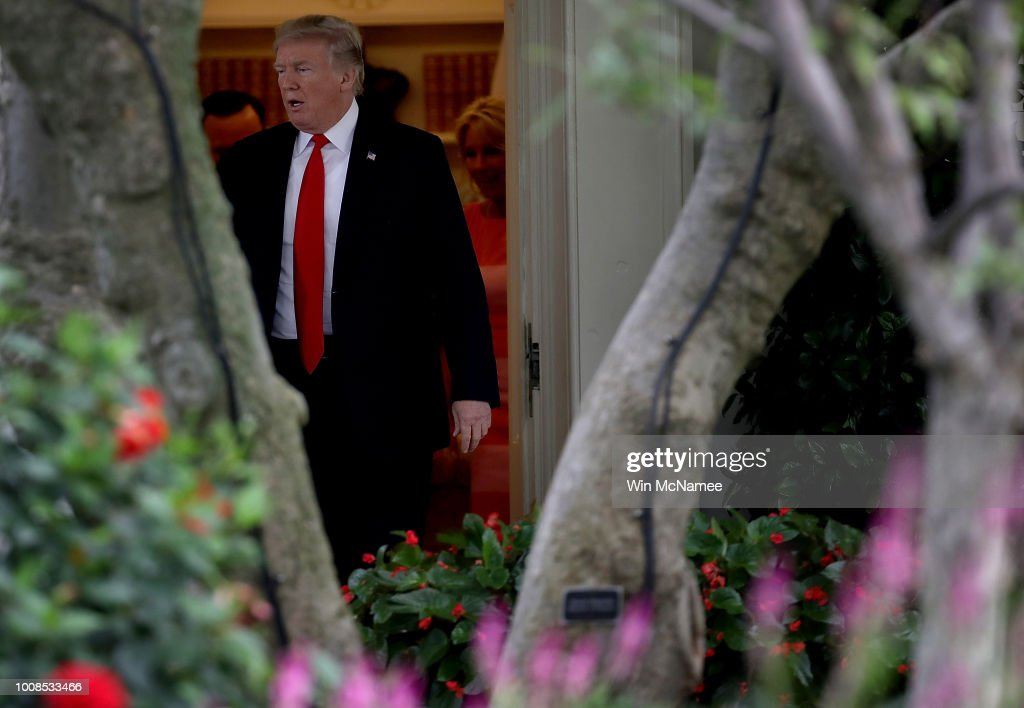 U.S. President Donald Trump leaves the Oval Office as he departs the White House July 31, 2018 in Washington, DC. Trump is scheduled to travel to Tampa, Florida where he will attend a campaign rally for Rep. Ron DeSantis (R-FL), who is running for governor.