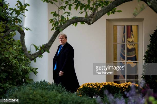 President Donald Trump leaves the Oval Office as he prepares to board Marine One on the South Lawn of the White House on October 26 2018 in...