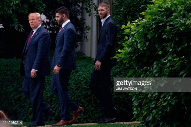 US President Donald Trump leaves the Oval Office followed by professional baseball players JD Martinez and Chris Sale after he welcomed the 2018...