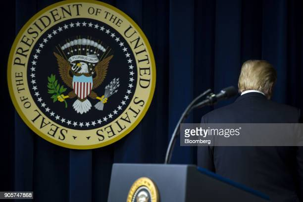 US President Donald Trump leaves the podium after speaking during a 'Conversations with the Women of America' event at the Eisenhower Executive...