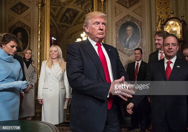 US President Donald Trump leaves the President's Room of the Senate at the Capitol after he formally signed his cabinet nominations into law in...