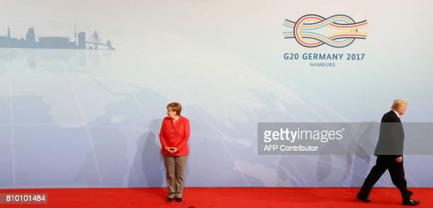 US President Donald Trump leaves the stage after he was welcomed by German Chancellor Angela Merkel for the G20 summit in Hamburg northern Germany on...
