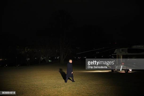 S President Donald Trump leaves the White House for the World Economic Forum in Davos Switzerland January 24 2018 in Washington DC Trump told...