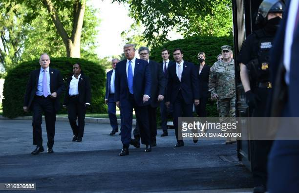 US President Donald Trump leaves the White House on foot to go to St John's Episcopal church across Lafayette Park in Washington DC on June 1 2020 US...
