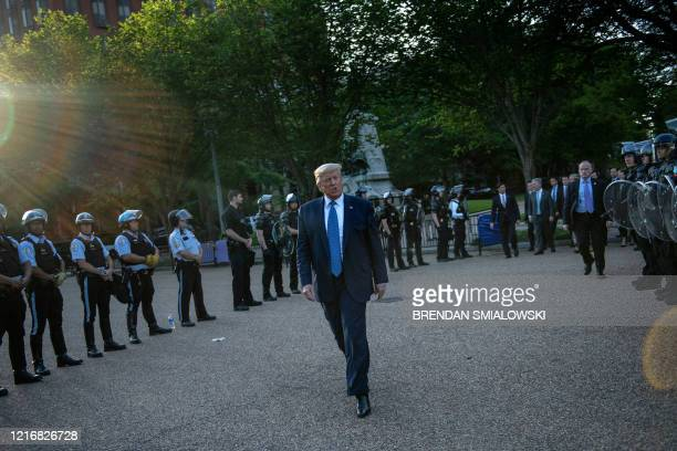 President Donald Trump leaves the White House on foot to go to St John's Episcopal church across Lafayette Park in Washington DC on June 1 2020 US...