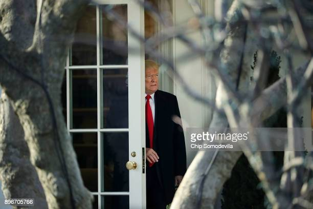 S President Donald Trump leaves the White House to visit troops at Walter Reed Bethesda Naval Medical Center December 21 2017 in Washington DC Trump...