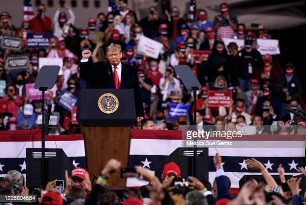 President Donald Trump leaves to cheers from a crowd during a Make America Great Again campaign rally on September 19, 2020 in Fayetteville, North...