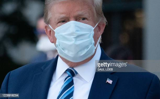 President Donald Trump leaves Walter Reed Medical Center in Bethesda, Maryland heading to Marine One on October 5 to return to the White House after...
