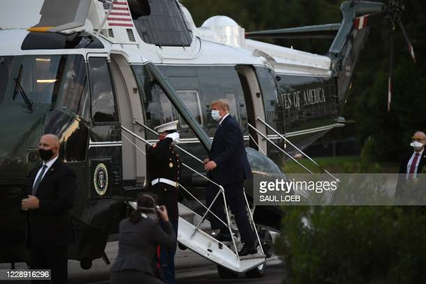 President Donald Trump leaves Walter Reed Medical Center in Bethesda, Maryland boarding Marine One on October 5 to return to the White House after...