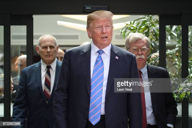 President Donald Trump leaves with Chief of Staff John Kelly and National Security Advisor John Bolton after holding a press conference ahead of his...