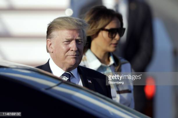 US President Donald Trump left and First Lady Melania Trump arrive at Haneda Airport in Tokyo Japan on Saturday May 25 2019 With USJapan tensions...