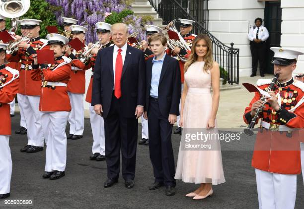 S President Donald Trump left and First Lady Melania Trump attend the annual Easter Egg Roll on the South Lawn of the White House in Washington DC US...
