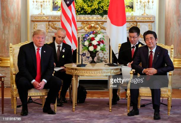 President Donald Trump, left, and Japanese Prime Minister Shinzo Abe hold a talk at Akasaka Palace, Japanese state guest house on May 27, 2019 in...