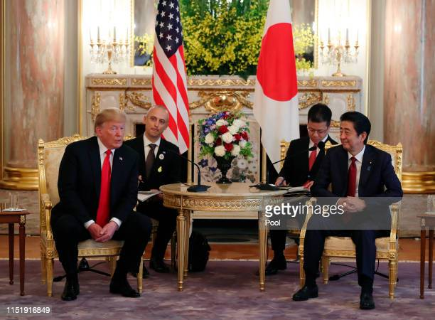 S President Donald Trump left and Japanese Prime Minister Shinzo Abe hold a talk at Akasaka Palace Japanese state guest house on May 27 2019 in Tokyo...