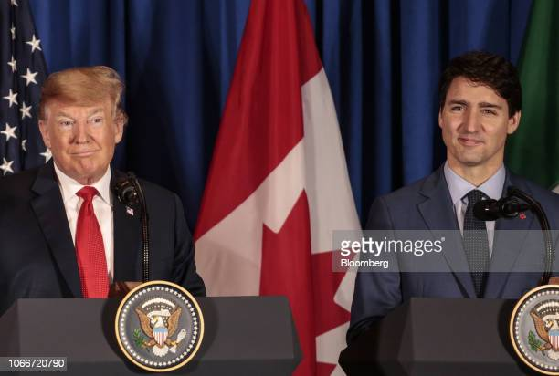 US president Donald Trump left and Justin Trudeau Canada's prime minister smile during a news conference before the signing of the United...