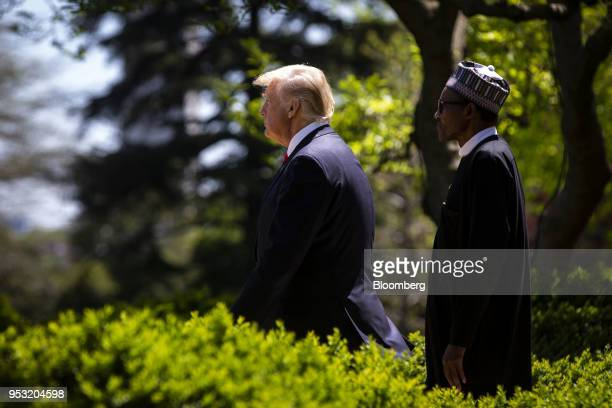 US President Donald Trump left and Muhammadu Buhari Nigeria's president arrive to a news conference in the Rose Garden of the White House in...